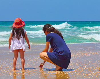 Mother and daughter Clamming on the beach!